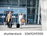 business couple in coats... | Shutterstock . vector #1069245500