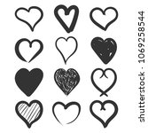 set of the hand drawn hearts...   Shutterstock .eps vector #1069258544