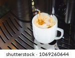 close up of espresso pouring... | Shutterstock . vector #1069260644