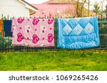 Stock photo colorful bed sheets outside on the rope 1069265426