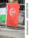 London, United Kingdom, 14th April 2018:- The flag of the PFLP at a gathering of protesters along Kensington High Street, near the Israeli Embassy in London to protest the occupation of Palestine - stock photo