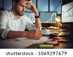 serious businessman thinking... | Shutterstock . vector #1069297679