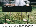 tasty grilled meat on metal... | Shutterstock . vector #1069304858