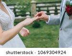 loving couple holding hands... | Shutterstock . vector #1069304924