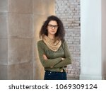 portrait of smiling young woman ... | Shutterstock . vector #1069309124