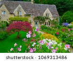 garden and house in uk style.... | Shutterstock . vector #1069313486