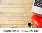 red safety engineer helmet... | Shutterstock . vector #1069322180