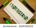 Small photo of Text sign showing Understand Motivational Call. Conceptual photo Know Perceive the meaning of something written on Notebook Book on the wooden background Pen and Markers next to it.