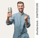 young handsome man  blue denim...   Shutterstock . vector #1069333100