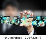businessman holding picture   Shutterstock . vector #106933649