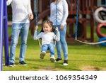 happy daughter is enjoying to... | Shutterstock . vector #1069354349