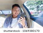 asian man using smartphone... | Shutterstock . vector #1069380170