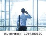 smart asian man using... | Shutterstock . vector #1069380830