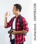 attractive tourist man with... | Shutterstock . vector #1069381238