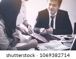 business partners signing... | Shutterstock . vector #1069382714