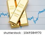 Stock photo gold bar bullion stack on rising price graph as financial crisis or war safe haven financial 1069384970