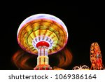 motion blurred ride at a county ... | Shutterstock . vector #1069386164