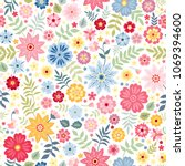 seamless ditsy floral pattern... | Shutterstock .eps vector #1069394600
