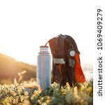 thermos and cup of hot beverage ... | Shutterstock . vector #1069409279