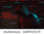 Small photo of Data breach concept with faceless hooded male person, low key red and blue lit image and digital glitch effect