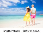 happy young couple walking and... | Shutterstock . vector #1069415366