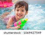 happy asian little child girl... | Shutterstock . vector #1069427549