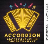 accordion music instrument neon ... | Shutterstock .eps vector #1069434116