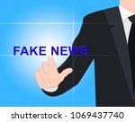 man pushing fake news glowing... | Shutterstock . vector #1069437740