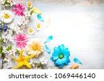 spring summer flowers on wooden ... | Shutterstock . vector #1069446140