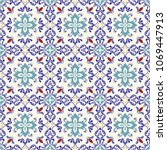 seamless colorful pattern in... | Shutterstock .eps vector #1069447913