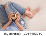 top view on girl in jeans... | Shutterstock . vector #1069453760