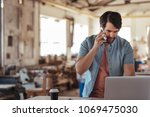skilled young craftsman... | Shutterstock . vector #1069475030