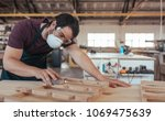 skilled young woodworker... | Shutterstock . vector #1069475639