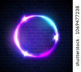 glowing circle with neon lights ... | Shutterstock .eps vector #1069477238
