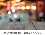 old wooden table on front ... | Shutterstock . vector #1069477730