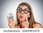 funny geek or nerd school woman ... | Shutterstock . vector #1069491470