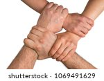four human arms crossed and... | Shutterstock . vector #1069491629
