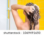 attractive woman washing her... | Shutterstock . vector #1069491650
