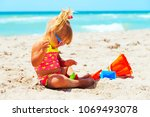 cute little girl play with sand ... | Shutterstock . vector #1069493078
