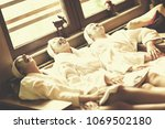 group of famale friends in spa... | Shutterstock . vector #1069502180