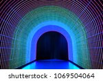 tunnel of rainbow led light | Shutterstock . vector #1069504064