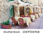 nice and cosy sidewalk cafe in... | Shutterstock . vector #1069506968