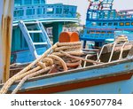 a large blue boats tethered to... | Shutterstock . vector #1069507784