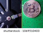 silver souvenir coin bitcoin on ... | Shutterstock . vector #1069510403