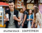 man bought coffee and hotdog.... | Shutterstock . vector #1069559834