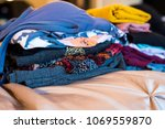 stack of women's shirts and... | Shutterstock . vector #1069559870
