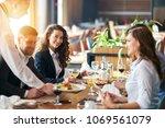 dinner after a buissnies... | Shutterstock . vector #1069561079