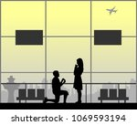 romantic proposal on airport of ... | Shutterstock .eps vector #1069593194