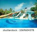 water park sliders with pool  | Shutterstock . vector #1069604378