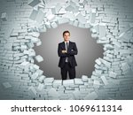 smiling businessman and brick... | Shutterstock . vector #1069611314